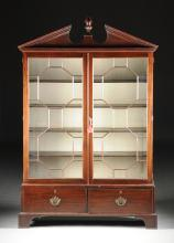 A GEORGE III CARVED MAHOGANY BOOKCASE CABINET, CIRCA 1800,