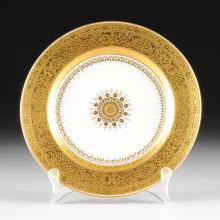 AN ASSEMBLED SET OF SEVENTEEN ELABORATE GILT MATCHING DINNER PLATES, BY WEDGWOOD, MINTONS, AND ROYAL CROWN DERBY, VARIOUS PRINTED AND IMPRESSED MARKS, 20TH CENTURY,