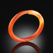 A RED CHINESE JADE BANGLE,
