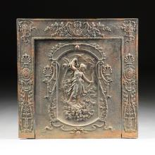 AN EMPIRE REVIVAL CAST IRON FIREPLACE FRAME AND COVER, CIRCA 1901,