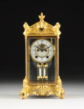 A ROCOCO REVIVAL GILT METAL AND GLASS CASED REGULATOR CLOCK, THOREAU PATTERN, EIGHT DAY MOVEMENT, BY THE NEW HAVEN CLOCK COMPANY, NEW HAVEN CONNECTICUT, LATE 19TH CENTURY,