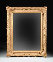 A PALATIAL LOUIS XV STYLE PARCEL GILT AND CARVED MIRROR, MODERN,