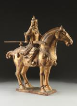 A CHINESE TANG DYNASTY STYLE PARCEL GILT CARVED WOOD EQUESTRIAN WARRIOR GROUP, 20TH CENTURY,