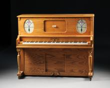 AN OAK LIBERTY PLAYER PIANO WITH BENCH, CIRCA 1991,