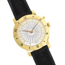 AN 18K YELLOW GOLD TISSOT NAVIGATOR WORLD TIME GENT'S WRISTWATCH,