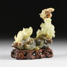 A CHINESE CELADON JADE SEA DRAGON AND FISH GROUP, POSSIBLY REPUBLIC PERIOD (1912-1949),