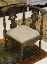 ITALIAN CARVED WALNUT CORNER ARM CHAIR