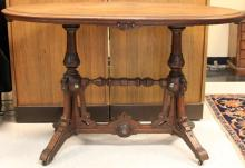 RENAISSANCE REVIVAL WALNUT OVAL LIBRARY TABLE