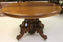 FRENCH CARVED WALNUT FIGURAL DINING TABLE