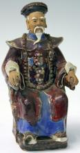 CHINESE ENAMELED POTTERY SEATED FIGURE