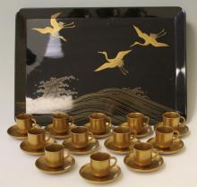 JAPANESE GOLD AND BLACK LACQUERED TEA SERVICE
