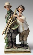 CONTINENTAL PORCELAIN FIGURAL STATUE OF FISHERMAN