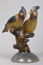 Ceramic figural group of tropical birds on branch