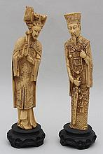 Pair of Asian resin figures on wood bases.