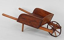Folky diminutive wood wheel barrow