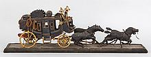 Model stage coach with figures and horses.