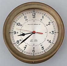 Brass ship's bell clock, The Otto Gerdau Co.