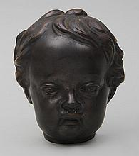 Bronze face of a child.