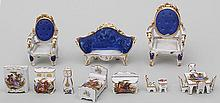 Group of (2) miniature porcelain furniture sets.