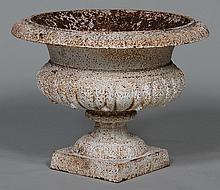 Cast iron urn.  15''h, 20''dia.
