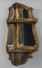 Carved giltwood and gesso mirrored wall mounted co