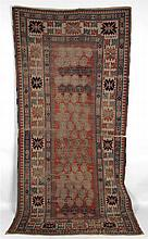 Oriental rug. 8'10''l, 4'2-1/2''w. Heavily worn.
