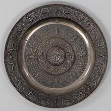 Large cast iron charger with relief mythological f