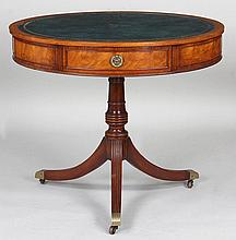 Small Regency style drum table with tooled leather