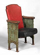 Cast iron foldup theatre seat with relief decorati