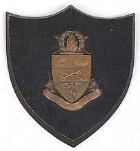 Wood plaque with bronze academic shield and banner