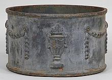 Cast iron round planter with urn and swag relief d