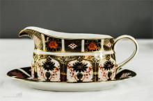 A Royal Crown Derby Old Imari Japan sauce boat and stand, no1128.