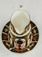 A Royal Crown Derby Old Imari Japan sauce boat and stand, 1128.