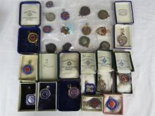 A quantity of twenty three fobs: fifteen silver and eight bronze.