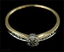 A 9ct gold and diamond cluster ring, size J, 1.2g.