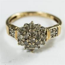 A 9ct gold and diamond cluster ring, size L, 2.5g.