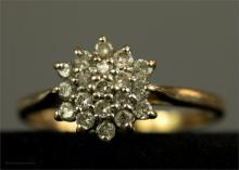 A 9ct gold and diamond cluster ring, size S, 2.3g.