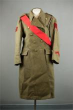 An Army overcoat, with Kings Crown, Sergeants sash and brass badges.