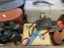 A quantity of binoculars and camera equipment including a 1960s Yashica cam
