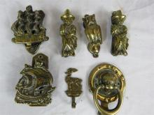 A quantity of brass door knockers, with pair of Welsh ladies, owl, two ship