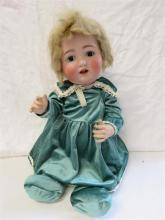 A German bisque head doll, marked CP 263 G7 to the neck.