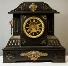 An Edwardian slate mantle clock, with decorative gilt metal Roman numeral d