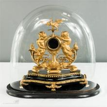 A Victorian gilt metal watch stand, with domed glass cover.