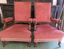 A pair of early 20th century pink velvet upholstered armchairs.