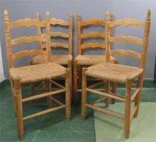 A set of four pine child's chairs with rush seats.