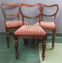 A group of three rosewood Victorian chairs with shaped backs and upholstere