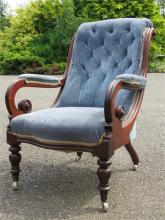 A Victorian mahogany nursing chair, with button back, boldly scrolling arms