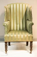 A 19th century wing back arm chair, upholstered in green silk.