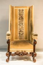 A Charles II style high back arm chair, upholstered in velvet with a stumpw