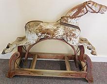 Folk art rocking horse in white paint